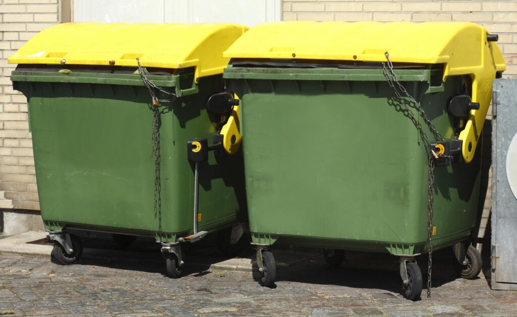 two green big dumpsters